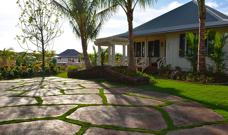 Kukui'ula means living garden, and the coveted cottage club properties on Kauai are a lush collection of Hawaii's finest landscapes. Unlimited Construction, a Hawaii-based construction firm, enlisted No Ka Oi Landscaping to install and maintain this property's extensive landscaping.