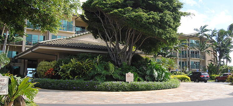 Waipouli Beach Resort's entryway is encased in a lush, tropical landscape.