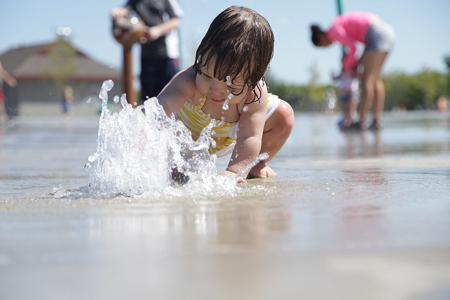 Child in a splash pad